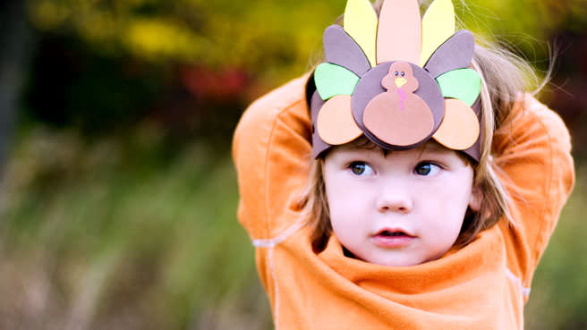 girl with thanksgiving hat on