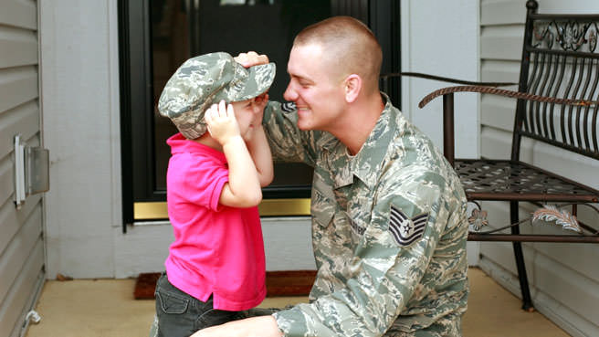military dad talking with child