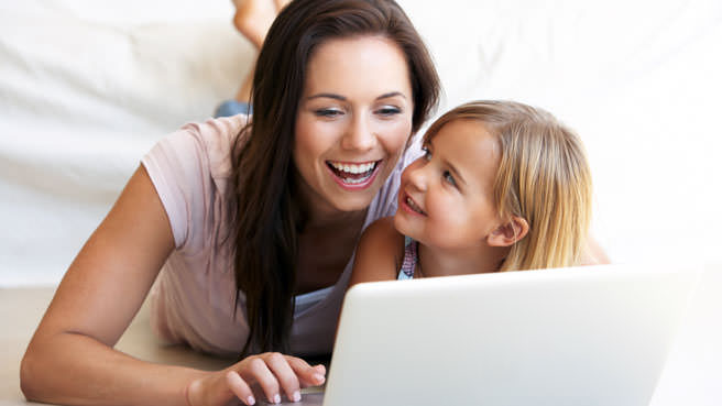 mother on computer with daughter