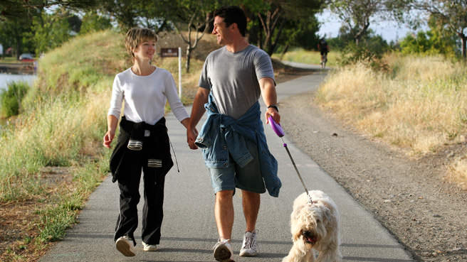 couple walking dog