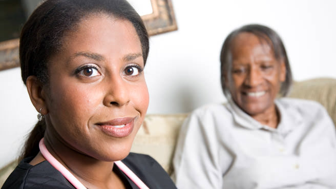 elderly woman with home caregiver