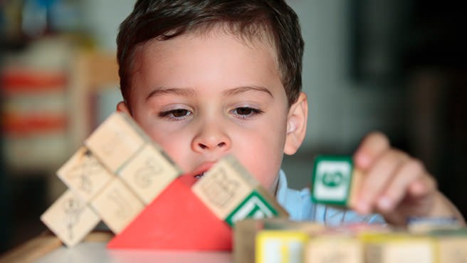 boy playing with blocks