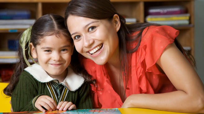 tutor and girl smiling
