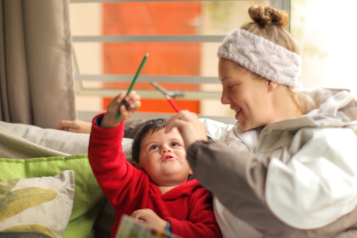 Nanny playing with child