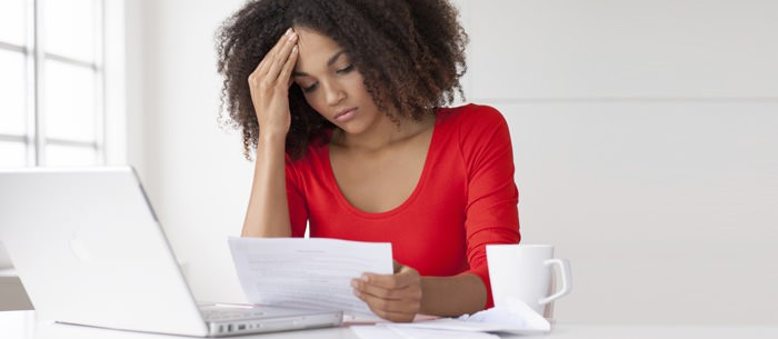 woman filling out tax forms