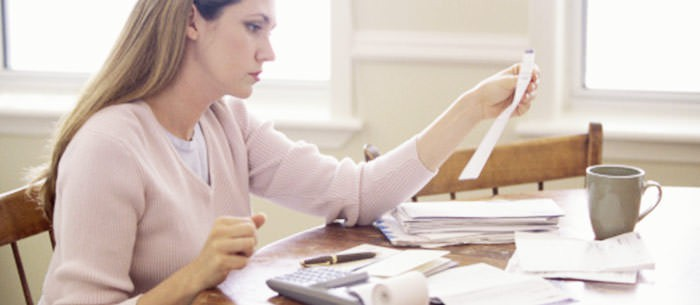 woman filling out paperwork